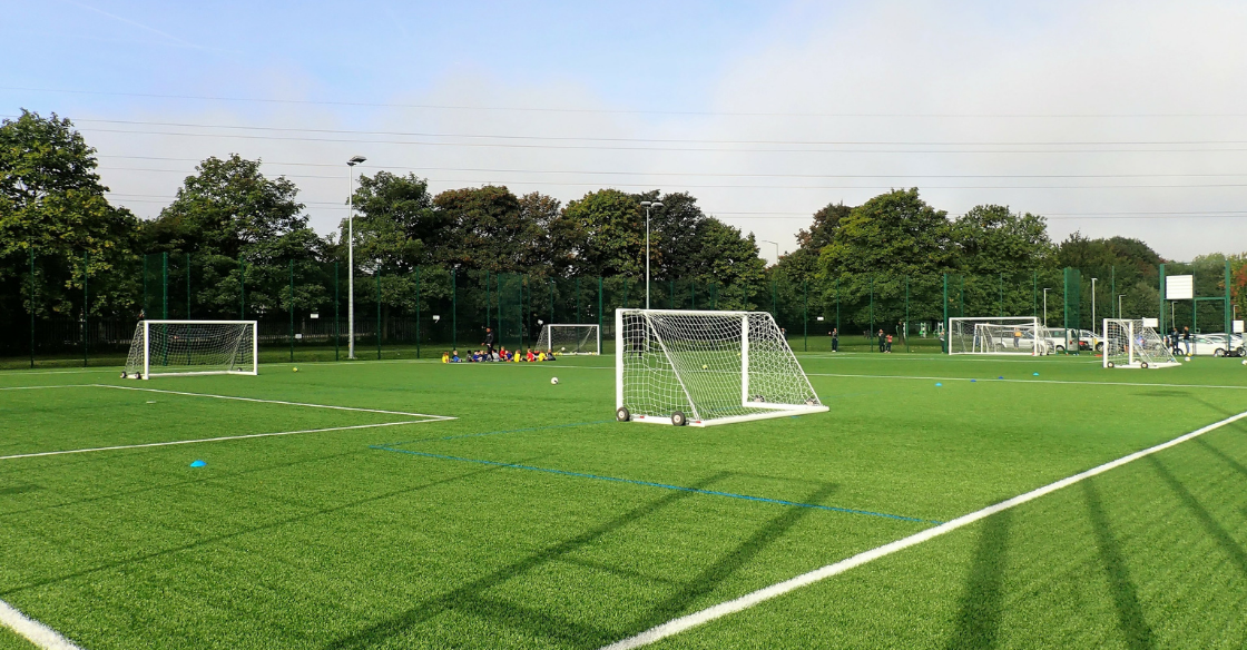 A soccer field landscaped by artificial turf.