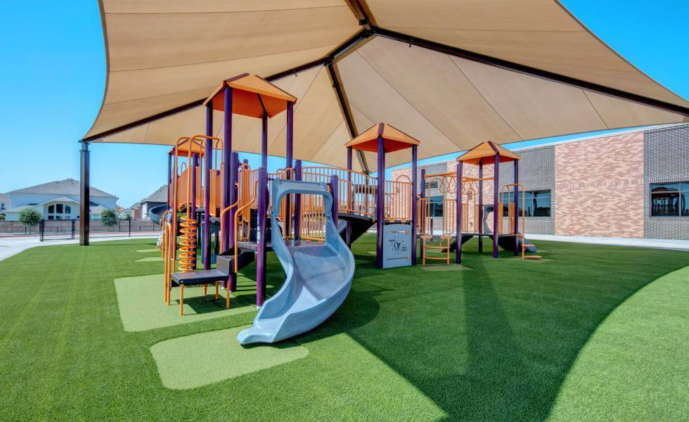 Frisco Independent school district jungle gym on SYNLawn Houston artificial playground turf