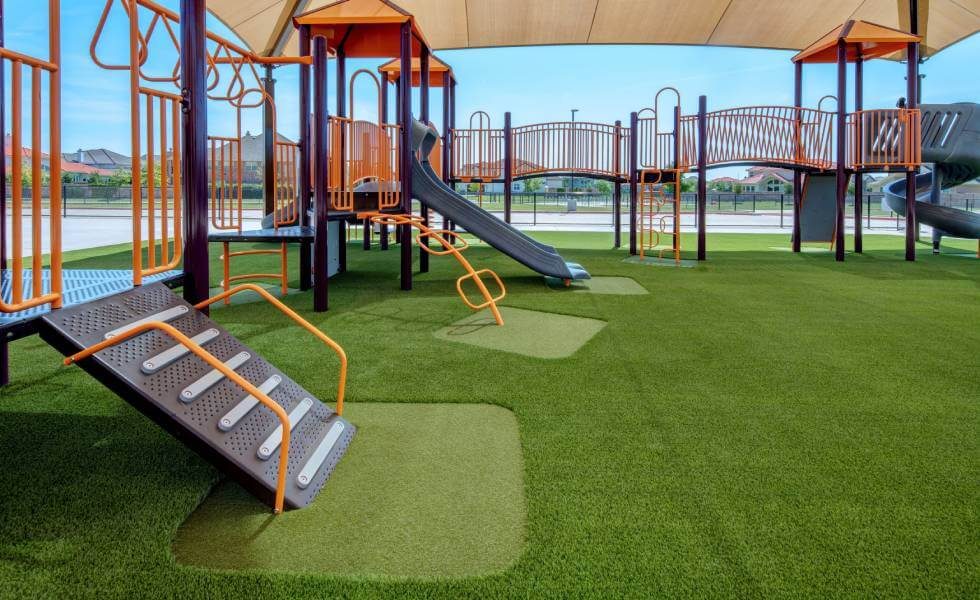 Jungle gym installed in Frisco Independent School District on SYNLawn Houston artificial grass