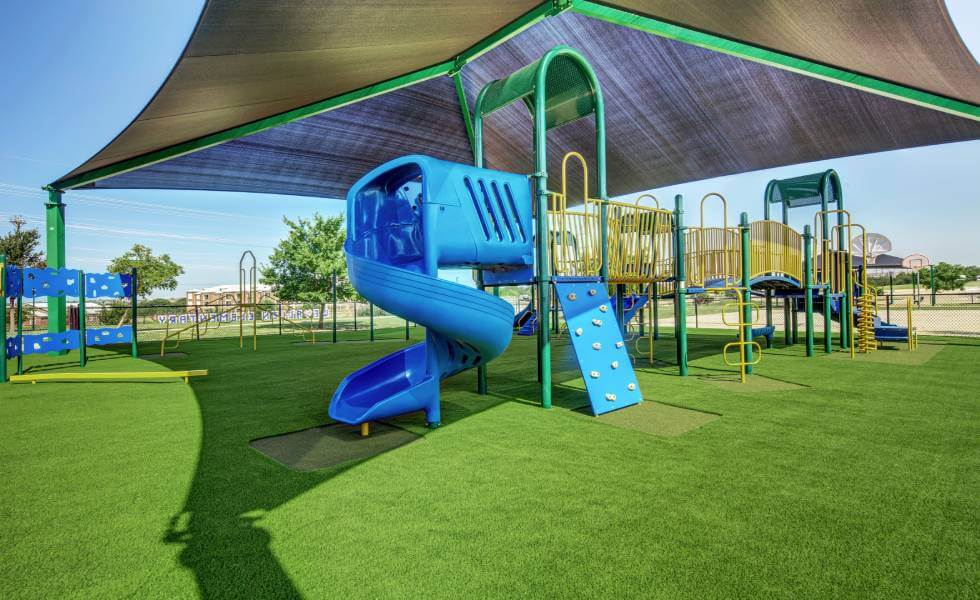 Blue Jungle Gym installed on SYNLawn playground turf for frisco independent school district